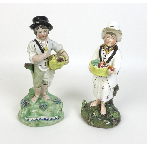 29 - A John Walton Staffordshire pearlware figure, circa 1830, modelled as a baker's boy selling bread fr...