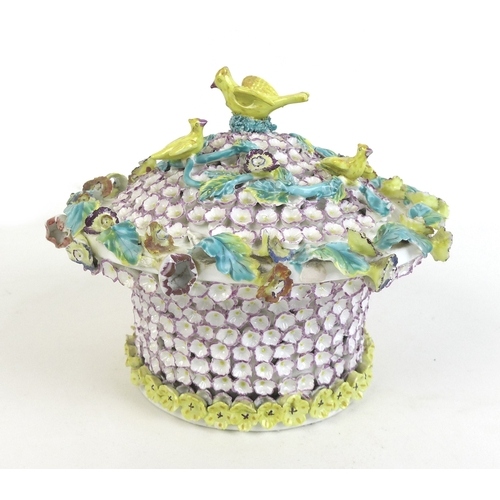 41 - A 19th century porcelain bowl and cover, in the Meissen schneeballen style, encrusted all over with ...