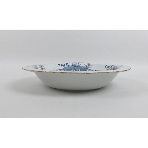 27 - An 18th century Delft pottery tin glazed dish, decorated in blue and white in Chinese style, 35 by 6...
