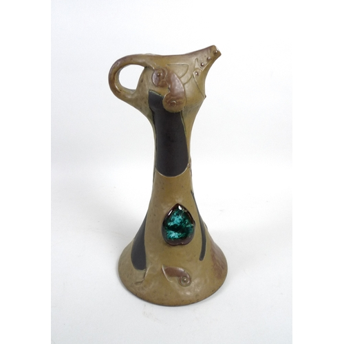 20 - An early 20th century Bretby pottery ewer, with colourful inlays, 31.5cm high....