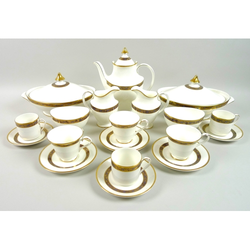 7 - A Royal Doulton part dinner and coffee service, decorated in the Harlow pattern, H5034, eight person...