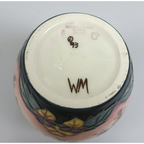 55 - Two pieces Moorcroft Oberon pattern pottery, a ginger jar with lid, with an impressed jug date mark ...
