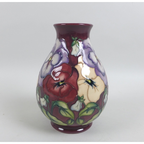 54 - A Moorcroft pottery pansy pattern baluster vase, with initialled 'WM' and impressed diamond date mar...