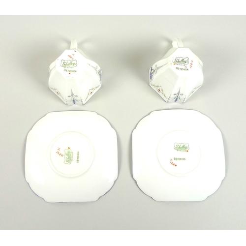 21 - A Shelley Queen Anne shape 'Blue Iris' pattern tea set, comprising teapot, milk jug, sugar bowl, six...