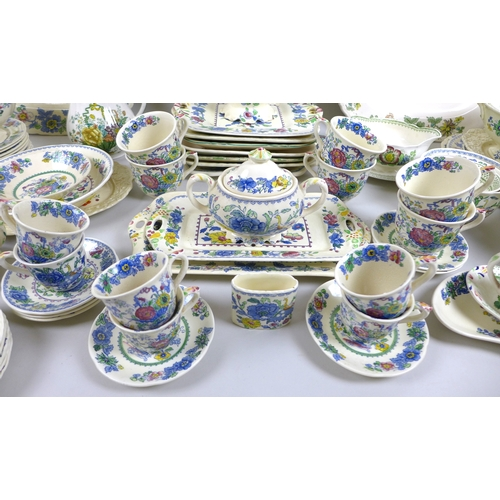 22 - A large collection of Mason's Ironstone china, including Regency, Paynsley, and Oak patterns, compri...