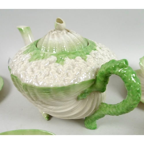 51 - A 19th century Belleek Neptune tea service with green tint, comprising a teapot, 21.5 by 13 by 12.5c...