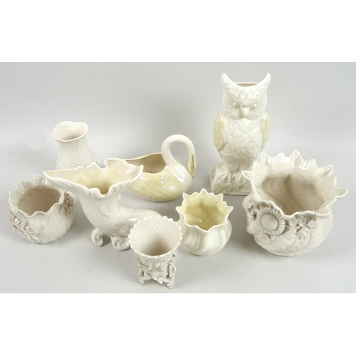48 - A collection of Belleek vases and pots, including a flowered cache pot, 11cm high, with second black...