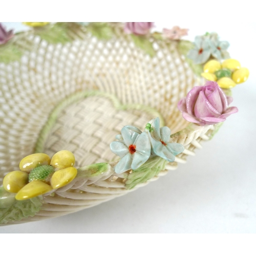 50 - A Belleek four strand heart shaped basket, with ornate flowers to the rim of the basket, applied ban...