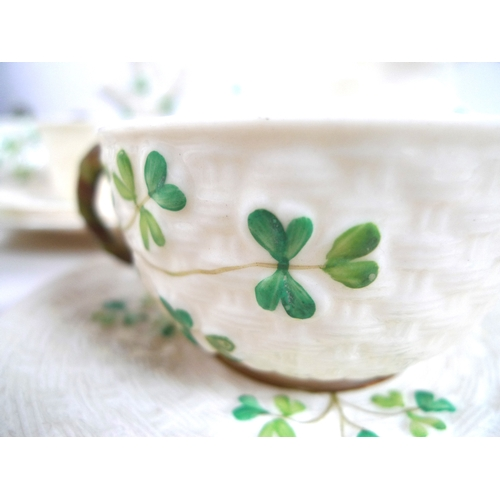 49 - A collection of Belleek Shamrock items, including a small teapot, second black mark to the base (189...