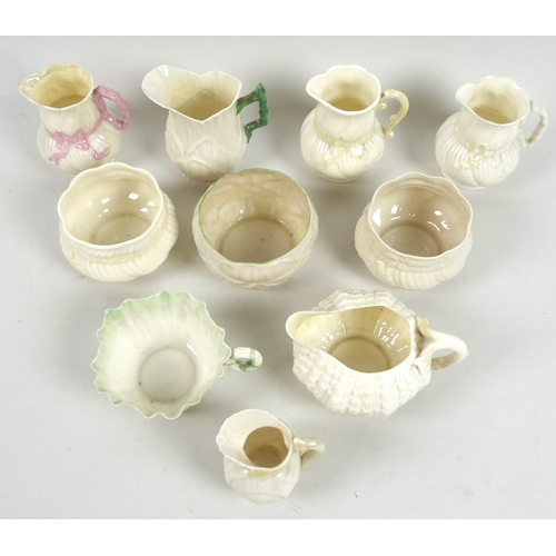 43 - A collection of Belleek jugs and sugar bowls, comprising a Toy Shell creamer jug with yellow lustre,...