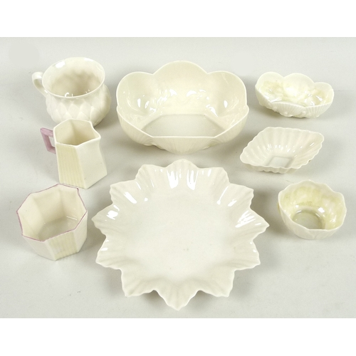 44 - A group of small Belleek wares, comprising a first period custard cup with imbricated surface decora...