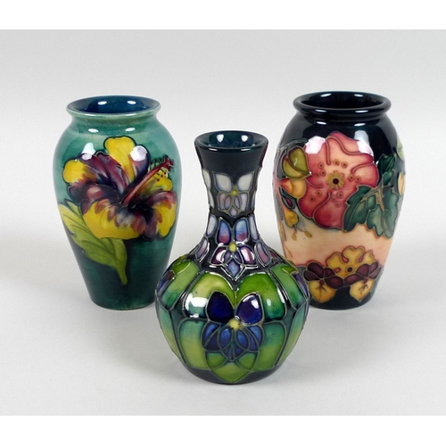 53 - A group of Moorcroft vases, comprising comprising an 'Oberon' pattern vase, with gate date stamp for...