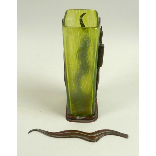 3 - An Art Nouveau iridescent green glass and metal vase, in the style of Loetz, the rectangular section...