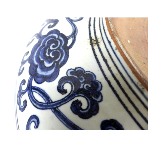 107 - A large Chinese Ming style blue and white dish, probably early 20th century, decorated in underglaze...