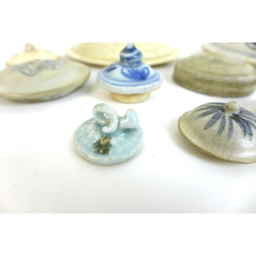 67 - A group of Chinese and Vietnamese pot lids, including a Song pot lid with celadon glaze, 14.2cm diam...