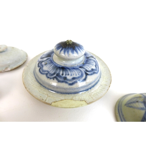 68 - A group of sixteen Chinese and Vietnamese pot lids, including a 19th century blue and white decorate...