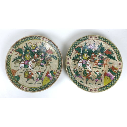 73 - A pair of early 20th century Chinese  porcelain famille vert style chargers, each decorated with a g...