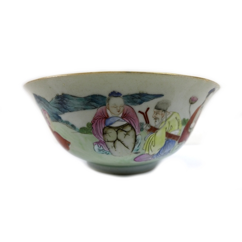 84 - A Chinese porcelain famille vert bowl, Qing Dynasty, 18th century, decorated with eight seated figur...