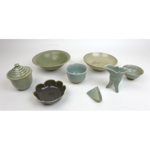 83 - A group of Chinese 18th century and later celadon wares, including a crackle glazed bowl with unglaz...