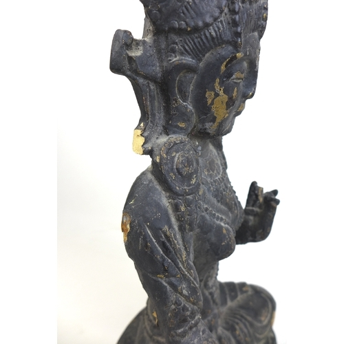 103 - A Tibetan bronzed Buddha figurine, with Kurana mudra hand position, 21.5 by 22 by 34cm high, and a c...