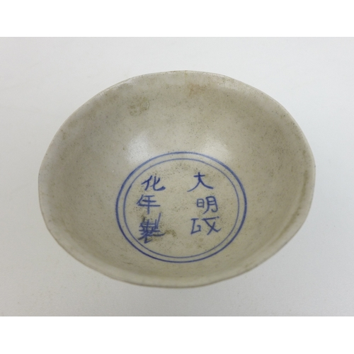 78 - A group of Chinese porcelain and ceramics, including a stem cup with Chengua style six character to ...