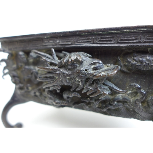 101 - A 19th century Chinese bronze incense burner, of rectangular form decorated with a greek pattern bor...
