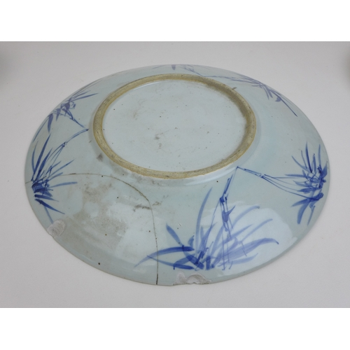98 - A group of 19th century Japanese porcelain and stoneware, including two blue and white chargers, one...