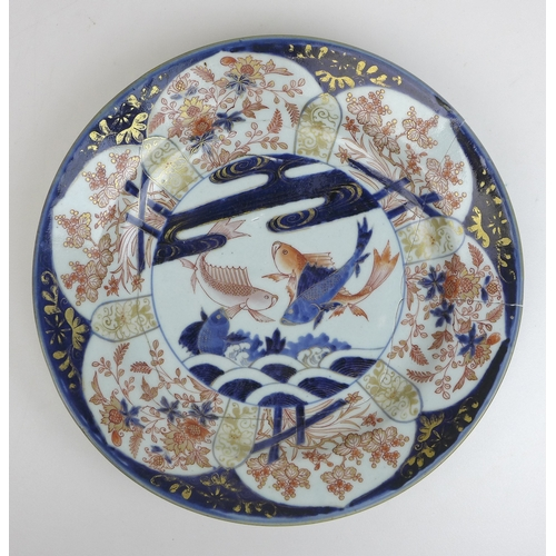75 - Seven pieces of 18th century and later Japanese porcelain and ceramics, including an imari pattern c...