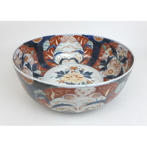 93 - A group of 19th century and later Japanese imari wares, including a bowl decorated internally and ex...