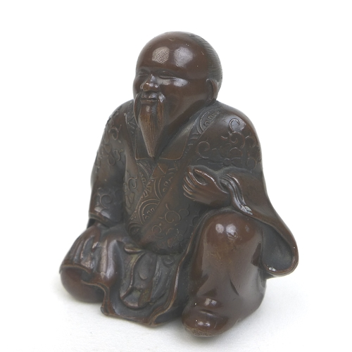61 - A group of small oriental Buddha figurines, an Indonesian seated Buddha in bronze 5 by 3 by 6.5cm hi...