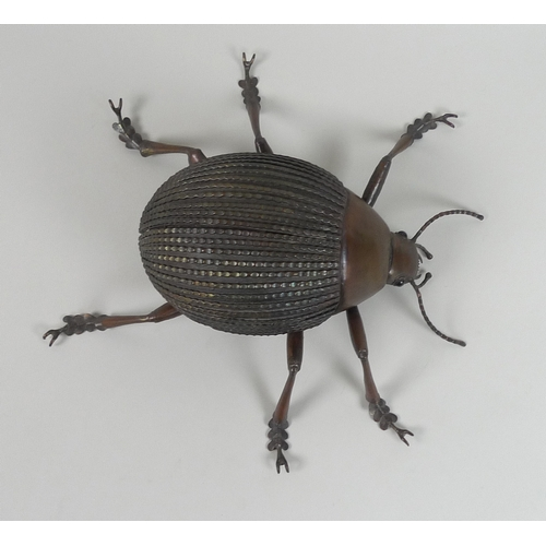130 - A late 20th century copper sculpture, modelled as a Tok Tokkis beetle, with blue stone inset eyes, s...