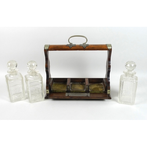 123 - A Victorian oak tantalus, EPNS mounted, engraved shield to front, a single and a pair of cut glass d...