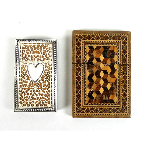 125 - Two 19th century card cases, one with fretwork carved and engraved ivory centred by a heart, on a wo...