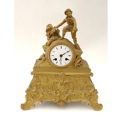 117 - A mid 19th century French ormolu figural mantle clock, with a figure of a 18th century hunter with h...