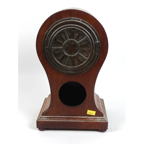 124 - An Edwardian mahogany balloon shaped mantel clock, inlaid with shell paterae, 8 day movement chiming...