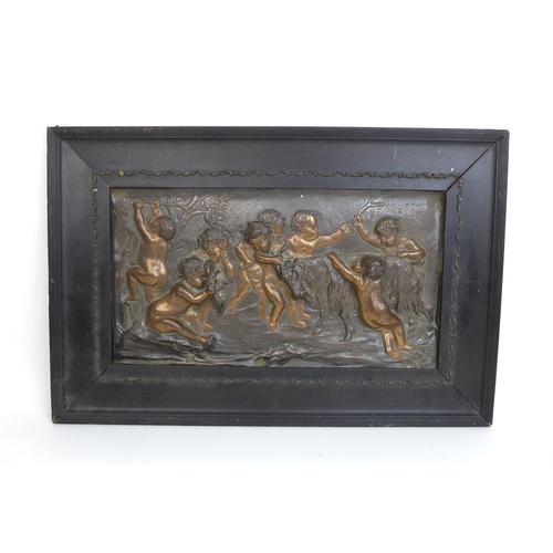 128 - After Francois Boucher (1703-1770) a 19th century bronzed panel 'Putti playing with a goat', unsigne...