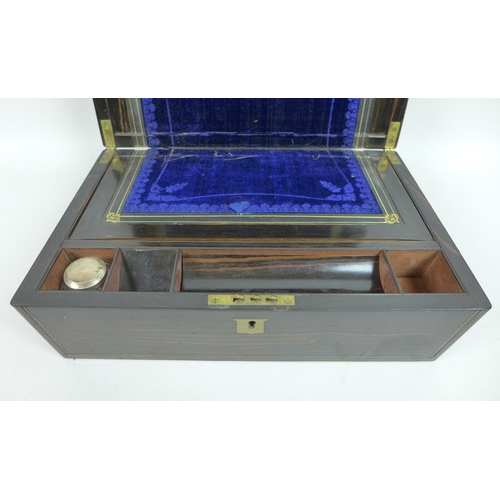 120 - A Victorian coromandel writing slope, with  secret drawer and key, lid with brass shield plaque engr...