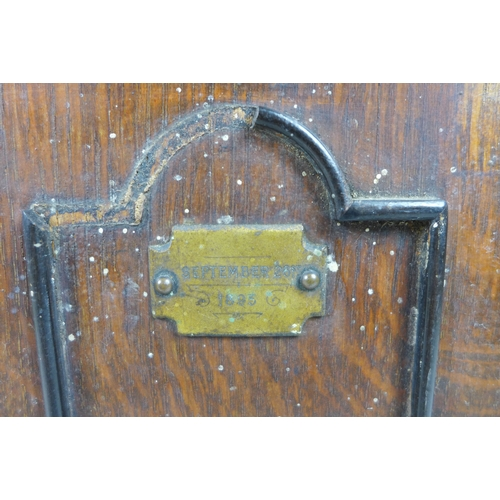 122 - A late Victorian smoker's cabinet, in the form of a safe with brass plaques to the twin doors, one e...