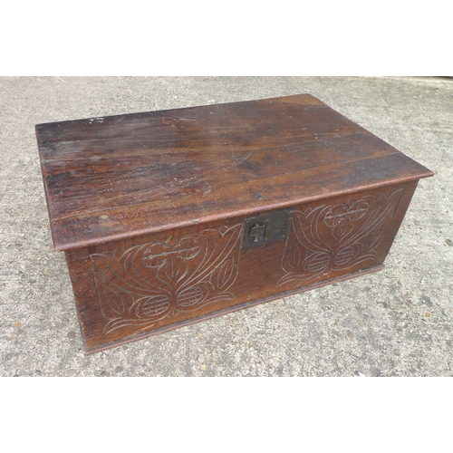 307 - 18th century oak bible box, with carved front, splits to lid, 48 by 29 by 25cm high....
