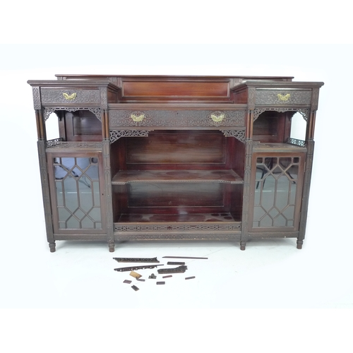 300 - A Gothic Revival mahogany sideboard, by Edwards & Roberts, circa 1890, with blind carved decoration,...