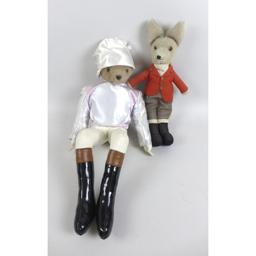 134 - Two vintage soft toys, a fox wearing a hunting outfit with red jacket, 45cm long, and a Casa Roma be...