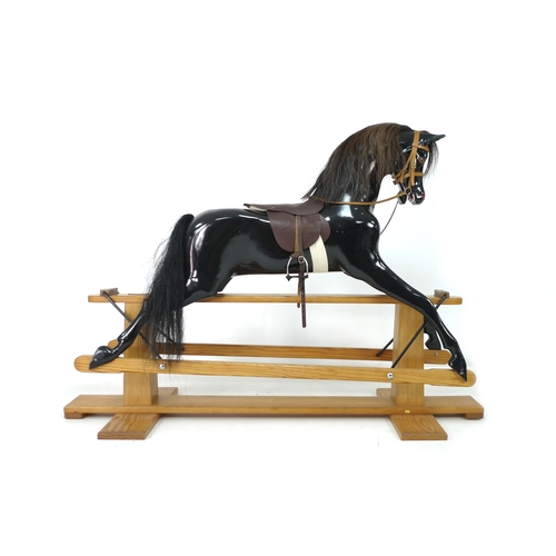 268 - ***BEING SOLD ON BEHALF OF CHILDREN IN NEED*** A Haddon Rockers rocking horse, circa 1980s, fibregla...
