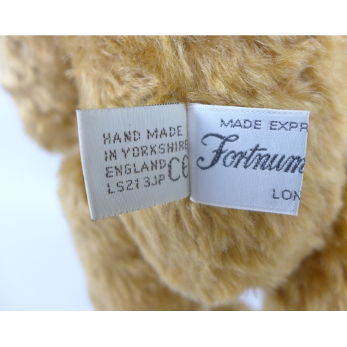 132 - A Fortnum and Mason jointed bear, with humped back, mohair fur, suede pads and complete with origina...
