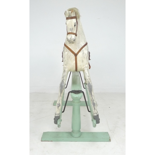 269 - An Edwardian G & J Lines extra carved rocking horse, painted dapple grey horse with brown leather sa...