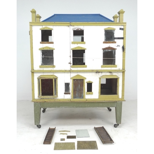 137 - A 19th century Georgian Manor style Dolls house, with three storeys, accessible from both front and ...