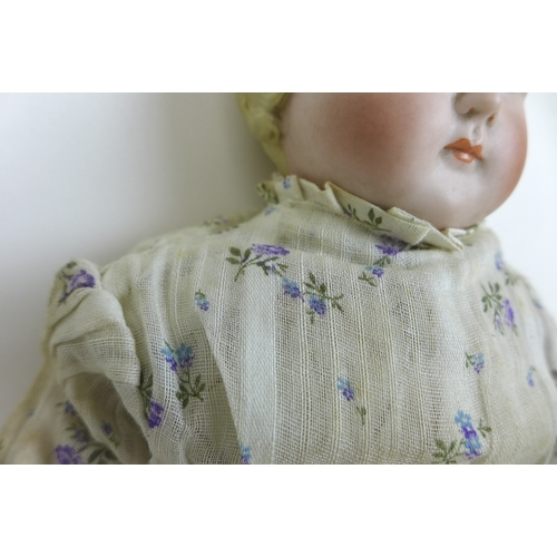 136 - A late 19th century early Alt, Beck and Gottschalk German Bisque headed child doll, marked to the ba...