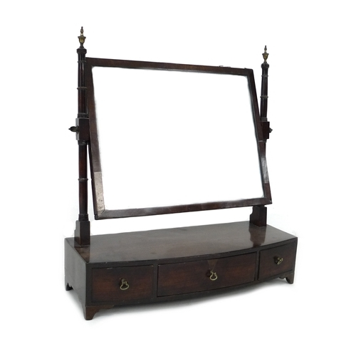 284 - A Georgian mahogany toilet mirror, with rectangular mercury glass mirror plate on turned supports wi...