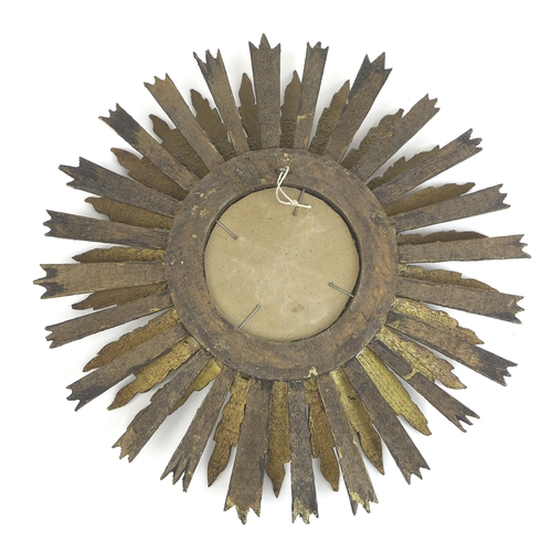 296 - A small 19th century French giltwood wall mirror, with sunburst frame, glass 8.7cm, 32cm overall....