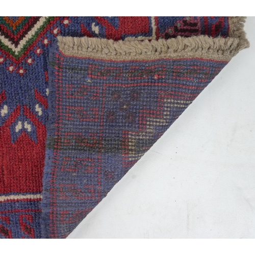 283 - A Gazak rug with two diamond medallions, 127 by 83cm....