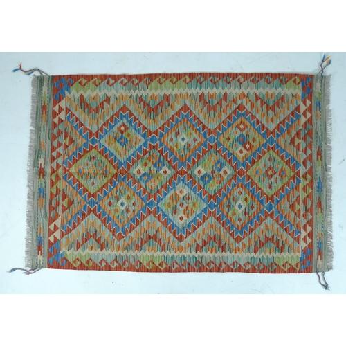 302 - A vegetable dyed wool Choli Kelim rug, 155 by 105cm....
